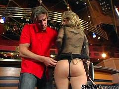 Click to watch this blonde babe, with giant knockers wearing sexy lingerie, while she gets fucked hard by a lusty fellow in a club.
