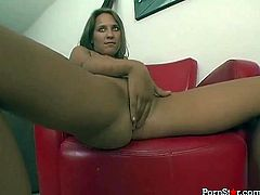 Well stacked cutie Sierra Snow gets rid of her mini skirt and top exposing her perky titties and her sweet bum. lady sits on chair and fondles her shaved cunt with her tender hands.