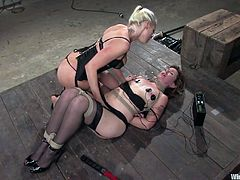 blonde electro mistress shocks and fingers her sex slave