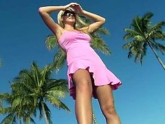 Hot blonde chick Alison Angel wearing a sundress is getting naughty in public. She flashes her shaved cunt and then rubs it passionately.