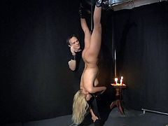 Cherry Kiss is on training of humiliation, hanged upside down.. she is just a toy to use, to whip and spank... really appropriate for pulling her breasts and nipples... Enjoy!
