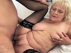 Our granny bounces her saggy tits like a cheap whore, ridding this dude's cock with her bald snatch. She's determined to receive every drop of cum he has and works his penis hard for that. After she rode the guy, granny gives him a short head and then lays on her back to get drilled. Finally she get's jizzed!