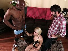 Tattooed blonde Ash Hollywood is doing all what she can to satisfy two men. She sucks and rubs their cocks and then gets her pussy pounded doggy style and in other positions.