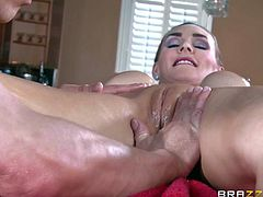 MILF Tanya Tate is a massage pro who gives instructions to inexperienced student Bruce Venture. Topless big titted woman makes him rub her body but suddenly he pulls down her white panties to stick his fingers in her pussy.