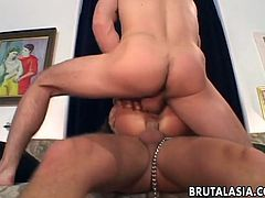 Two men dominate this submissive Asian whore with a collar on her neck. She sucks big dicks passionately. After that she gets fucked hard and deep in both holes at the same time.