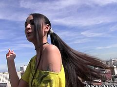 Exotic hottie Jade Hsu goes up on the roof to have a smoke and lets her sexy, long, jet black hair blow in the wind as she hangs out.