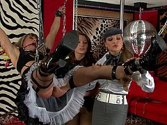Tied up and chained blonde maid by two elegant and hardcore milfs.
