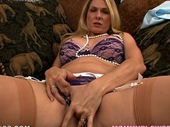 Hungry blonde MILF in nylon stockings Angela Attison rubs her cooch