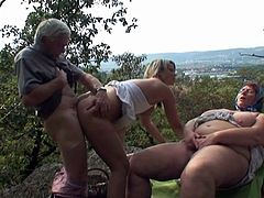 Young hottie enjoys the company of an old couple in outdoor porn adventure