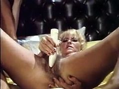 Horny and sexy sluts with wonderful tits and cute faces give a blowjob to the guy on the bed and fuck with dildo. Have a look in The Classic Porn sex video.