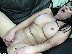 Naked girl with big tits fingers her hot cunt