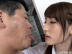 These two salarymen are being treated in a sexual way by this cute schoolgirl. She steps on one of the guy's faces and makes him sucks on her pantyhose covered feet. She rubs on his nipples and then, gets under him to suck his cock.