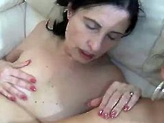 Two horny mature amateur lesbians are having some nice time together. They stroke each other's flabby tits and then finger each other's twats lazily.