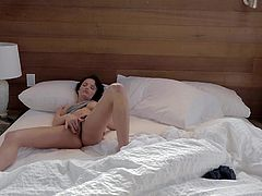 She's sexy and single so let's see what this dark haired beauty does in her bedroom. The lazy cutie wakes up, fools around in the bed and then begins to masturbate like a bitch. Yeah bitch keep on rubbing that pussy and show us what you got there!