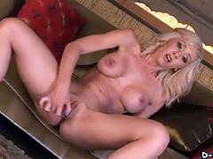 Amazing blonde chick Jessica Lynn strips and shows her fake tits for the camera. Then she fingers her shaved pussy ardently and slams it with a dildo.