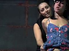 Top Grl brings you a hell of a free porn video where you can see how the naughty mistress Sister Dee bounds her slave and makes her cum hard in the dungeon.