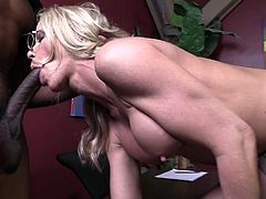 Simone Sonay the slutty mature woman sucks two big black cocks in her office. Then this slut gets banged in her vagina and creampied.