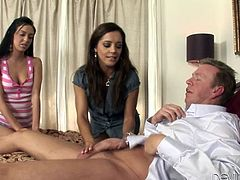 Watch both of these slutty ladies end up splattered by cum in this hot scene where she share this guy's thick cock in a threesome.