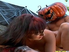 Get a hard dick watching this long haired babe, with natural boobs and a nice ass, while she goes hardcore with a guy under Halloween decorations.