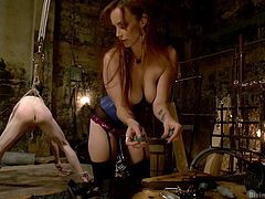 A good hard ass whipping is not enough for Bella, this devilish mistress wants to break Rob and succeeds! Rob stays there almost hanging and receives all that whipping on his ass and butt hole, until she has enough with that and wants to play a little game, a game of weights on his tortured cock.