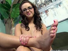After shooting her footjob scene, sexy Pressley relaxes backstage and uses some tissues to wipe the jizz from her pretty feet.