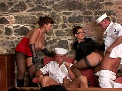 Two babes dominating two hunks in a nasty femdom porn show