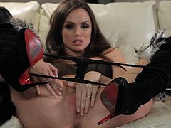 Captivating brunette Tori Black is getting naughty in the living room and lets her man watch her. She strokes her amazing body and then fingers her pussy and drills it with a dildo.