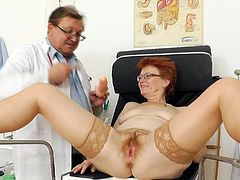 Jindriska loves feeling doc's hands stretching and rubbing her puffy mature cunt