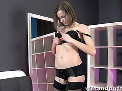 Xara is teasing in her black lingerie and stockings. She slowly strips and pulls down her panties before caressing her pussy with her fingers. She spreads her pussy lips apart and really teases them. Using a nipple pump, Xara pumps her labia with it until it is swollen and fingers her tight ass. She works both of her holes until her pussy is juicy and she orgasms!