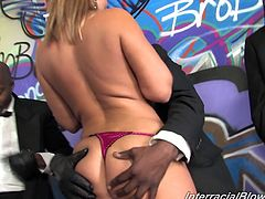 Hot blonde milf Brittany Angel shows her amazing boobs to a few black guys. Then she sucks and rubs the studs' weiners and feels happy to get loads of jizz on her face.