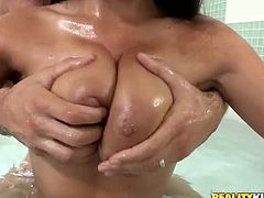 Miss Anissa is taking a bath and she's all nice and slippery. This guy pays her a visit in the bathroom and Anissa greets him between her big, natural breasts. She grabs his dick like the French whore she is, rubs it and then puts it between her wet, slippery boobs. It looks like her breasts could use a load of cum!