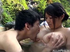The hot spring leads this couple to get kinky out in the wild. She opens up her legs for her man, as he sits in the water. He fingers her and her hairy pussy is dripping wet. Now he is going to eat her out.