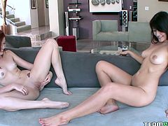 Two sexy induced bitches doing the cunt work on the sofa.