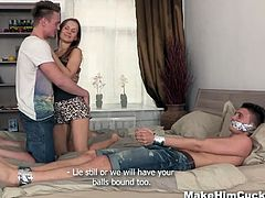 This stupid dude cheated on his super cute girlfriend and now she want to punish him too. He is all tied up and helpless and must watch how sweet she fucks with another guy.