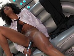 Take a nice look at this ebony babe, with a shaved pussy wearing high heels, while she uses a vibrator to satisfy her need in a solo model video.