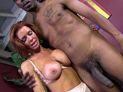 Have a blast watch this redhead cougar, with big fake tits wearing nylon stockings, while she plays around with a black dude and gets horny.