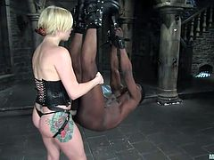 This guy thinks he is a man because he has a big black dick, but he is really just a pathetic slave. He is swaying back and forth when his blonde, white mistress puts her strap on in his anal cavity and thrusts away.
