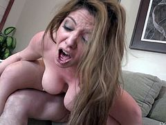 Get a load of Kiki Daire's big natural tits and her amazing ass where this hot milf gets fucked silly by as guy as she wears stockings.