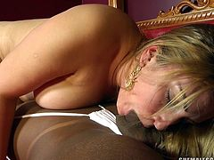 Jennifer Hills is a sexy tanned skinned ladyboy who wants to stick her juicy cock into her white lady friend. She bends her cute blonde girlfriend over the bed and licks her asshole and pussy then she fucks her hard from behind.