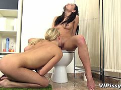 blonde & brunette play with their cunts and piss