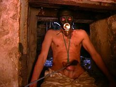 Somewhere deep in dungeon crazy business lady tortures her slave who has a mask over his head. Watch her torture his balls with a rope and whip and crawls back into the wall like his master demands him of!
