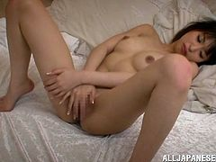 This short-haired Japanese hottie gets down on her knees to suck on her husband's cock. She hops on the bed and opens up her legs and her man follows. Watch as she guides him in and lets him go to town. Then she gets on top for a ride.