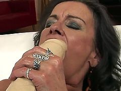 Mature nanny Sandora gets tired of playing solo with a dildo and luckily there is a got, young babe to fist and stretch her mature and used up slit wide open.