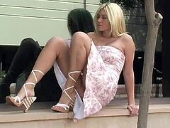 A sweet blonde in a dress flashes her boobs and pussy in public