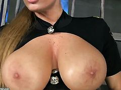 Blonde Sheila Grant touches her melons playfully