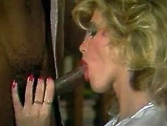 Filthy and kinky whore with nice boobs and light hair gets her mouth drilled by big black shlong. Have a look in steamy The Classic Porn xxx clip.