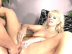 Stunning blonde gilf Merylin is riding on young Tarzans giant schlong zealously