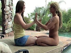 These two gorgeous babes strip naked, kiss, massage each other then have some sexy lesbian fun while swimming in a lake.