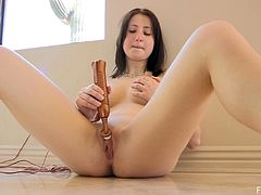 Shy brunette Veronika uses a toy to satisfy herself