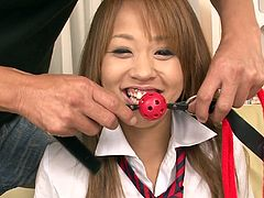 This Japanese slut gets a ball gag put in her mouth and she has to lay back, so this man can get kinky with her. He sticks a vibrator on her pussy and grabs her breasts, like a fucking pervert. Her arms are bound, so she has no choice, but to take the torture.